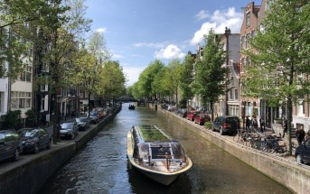 Amsterdam canal with tourist boat